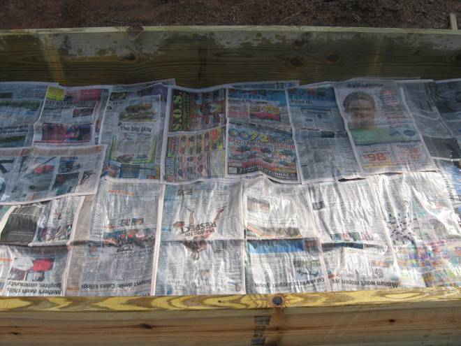 Wet newspaper layer